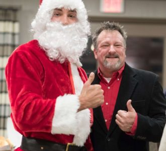 Santa Clause and a man giving the thumbs up sign