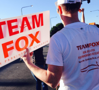 Person holding Team Fox sign